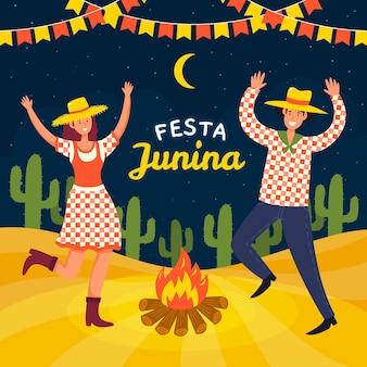 手描きのキャンプファイヤーの周りで踊るフェスタジュニーナの人々