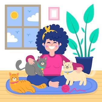 Счастливая девушка играет с кошками и собаками