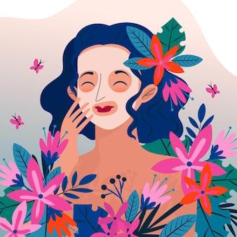 自然なフェイスマスクと花を持つ女性