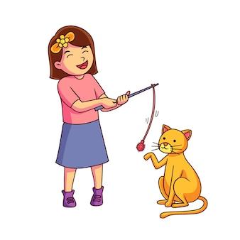 Девочка играет со своей кошкой