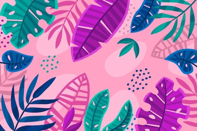 ファンキーなピンクの背景を持つ熱帯の葉