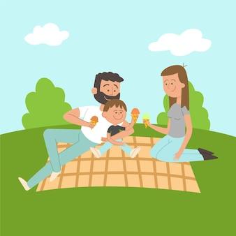 ピクニックで一緒に時間を楽しんでいる家族