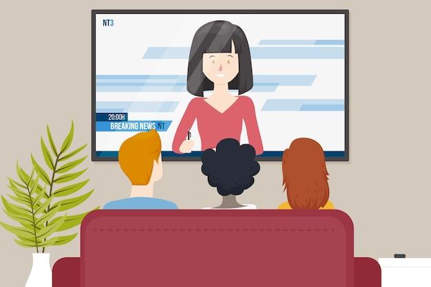 Семья смотрит новости в помещении