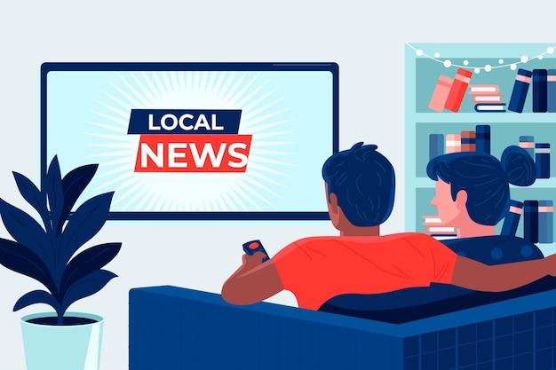 家でニュースを見ている人
