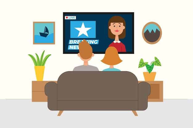Семья на диване смотрит новости