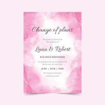 ピンクの水彩延期ウェディングカード