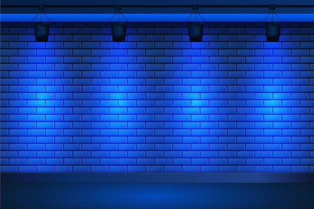 Точечные светильники на синем фоне кирпичной стены