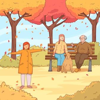 犬と一緒に秋の公園の人々