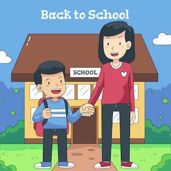 両親と一緒に学校に戻る子供