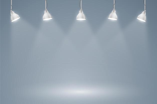 スポットライトの背景の吊り下げライト