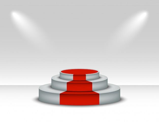 レッドカーペットと白い表彰台。白い背景の照明と勝者台座。授賞式のレッドカーペットで表彰台のシーン。