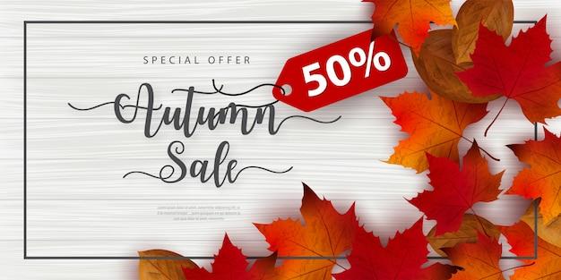 秋の販売バナーを葉で飾る
