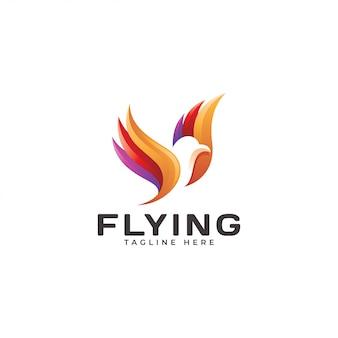 色とりどりの飛んでいる鳥の羽のロゴ