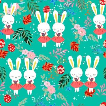 花フレームのシームレスなパターンでかわいい赤ちゃんイースターのウサギ