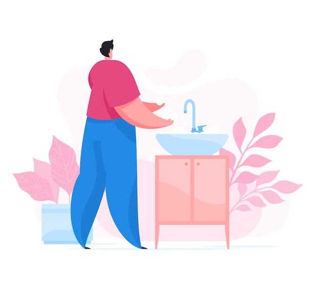 男は手を洗って、流しの上で細菌を取り除く