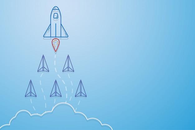 Концепция лидерства, командной работы и смелости, ракета для лидера и бумажные самолетики.
