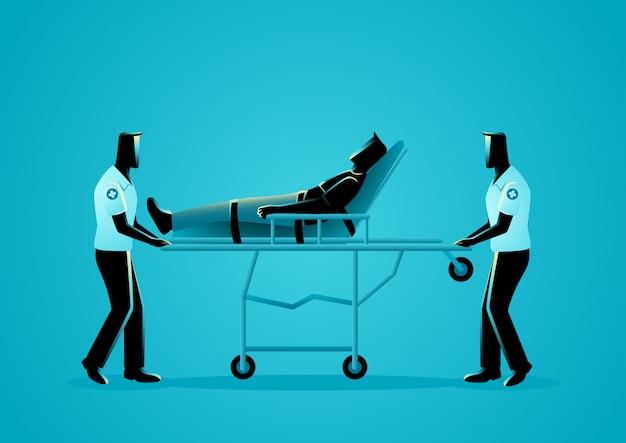 担架で負傷した男性を移動する救急隊