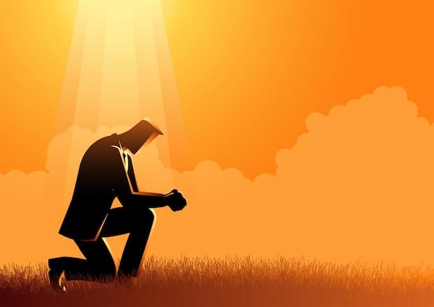 光の下で祈る男