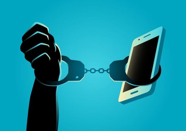 Рука наручники со смартфоном