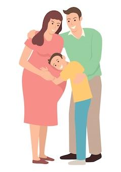 妊娠中の母親を抱いて少年