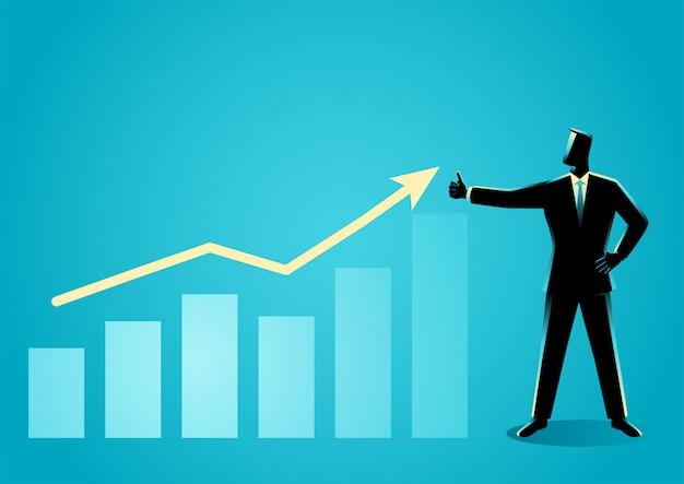 Бизнесмен позирует делать большой палец вверх с увеличением графической диаграммы