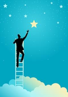 ビジネスマンは星に手を伸ばす