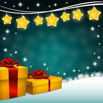 緑の背景にギフトボックスとクリスマススターの装飾
