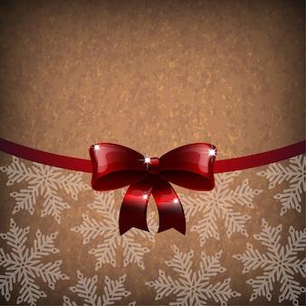雪片と弓のあるクリスマスペーパーの背景