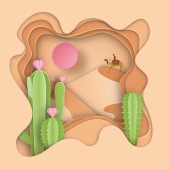 砂漠の風景とサボテンの植物のペーパーアート彫刻