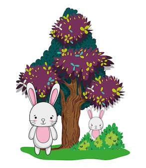 美容ウサギの友人動物や木