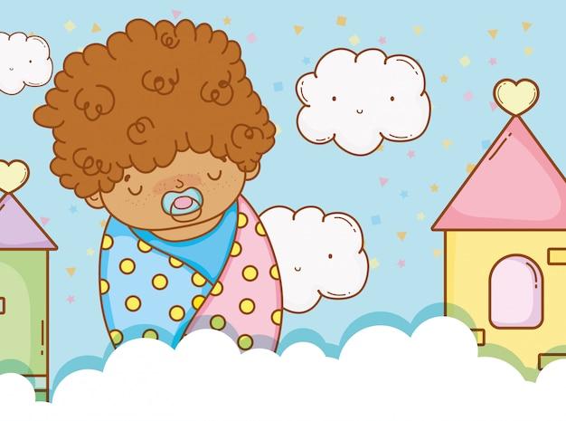 おしゃぶりと雲の毛布の赤ん坊の男の子