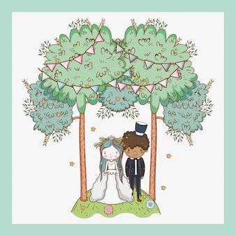パーティーの旗や木々で結婚する女性と男性