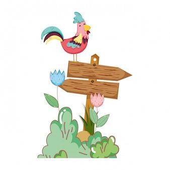 木製の矢印と鶏の庭
