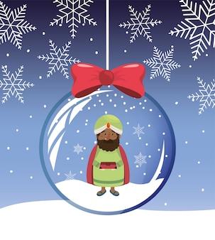 クリスタルボールの中にバルタザール王の魔術師がいる雪片