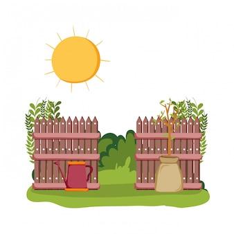 フィールドシーンのフェンスと庭のスプリンクラー