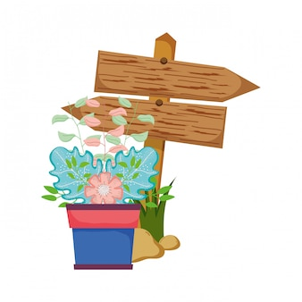 観葉植物と木製の矢印