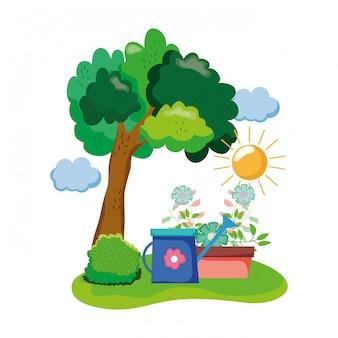 フィールドの観葉植物と庭のスプリンクラー