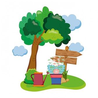 観葉植物とスプリンクラーの分野での木製の矢印