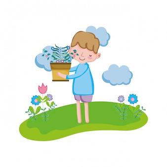 Маленький мальчик подъема комнатное растение в ландшафте