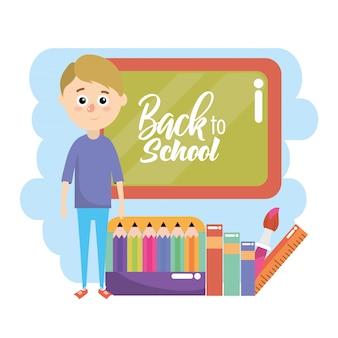 教育黒板とクレヨンと定規を持つ少年