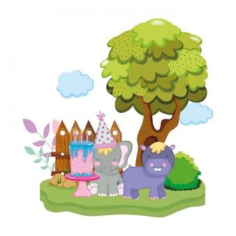 小さなカバとパーティの帽子を持つ象