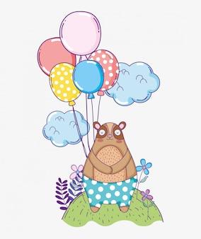 風船で幸せなクマの誕生日のお祝い