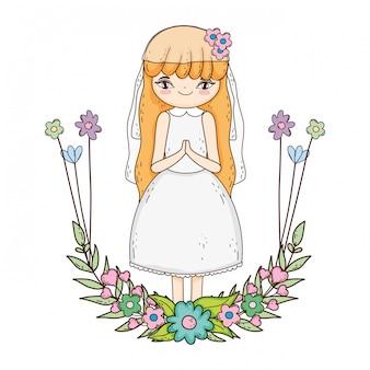 花輪の花の聖体拝領のお祝いを持つ少女