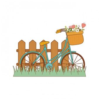 花のバスケットと風景の中のフェンスと自転車