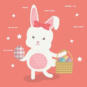 バスケットに描かれたイースターエッグとかわいいウサギ
