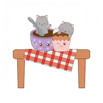 カップケーキかわいいキャラクターとかわいい小さな猫