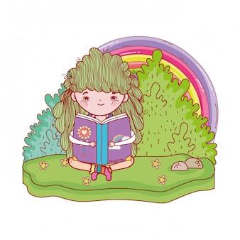 虹と本を読んでの幸せな女の子
