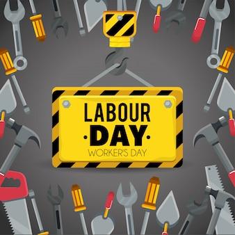 Эмблема со строительными инструментами на день труда