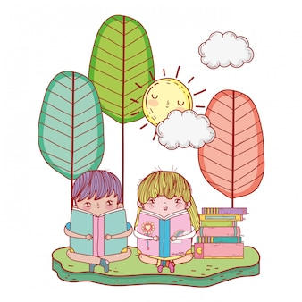 風景の中の本を読んで幸せな小さな子供たち