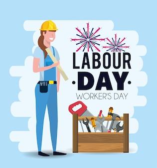 労働者の日に機器を持つ女性メカニック